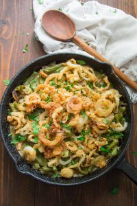 Skillet of Vegan Green Bean Casserole with Wooden Serving Spoon and Napkin
