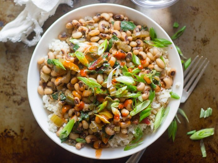 Bowl of Vegan Hoppin John Topped with Scallions