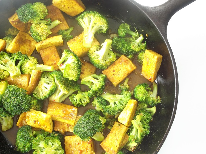 Malaysian Tofu Broccoli Stir Fry Over Creamy Coconut Grits
