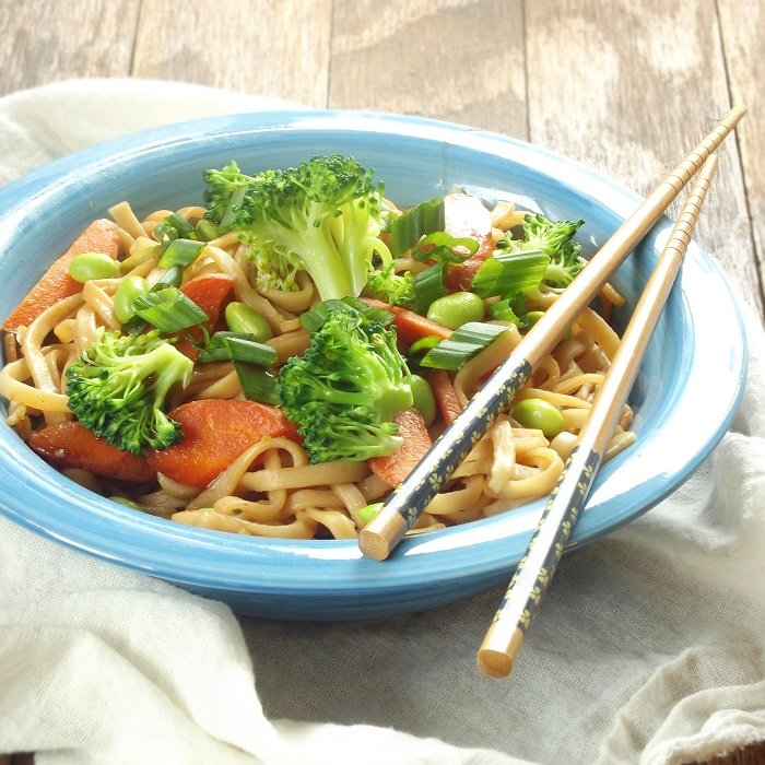Bowl of Teriyaki Noodles with Chopsticks Perched on the Side