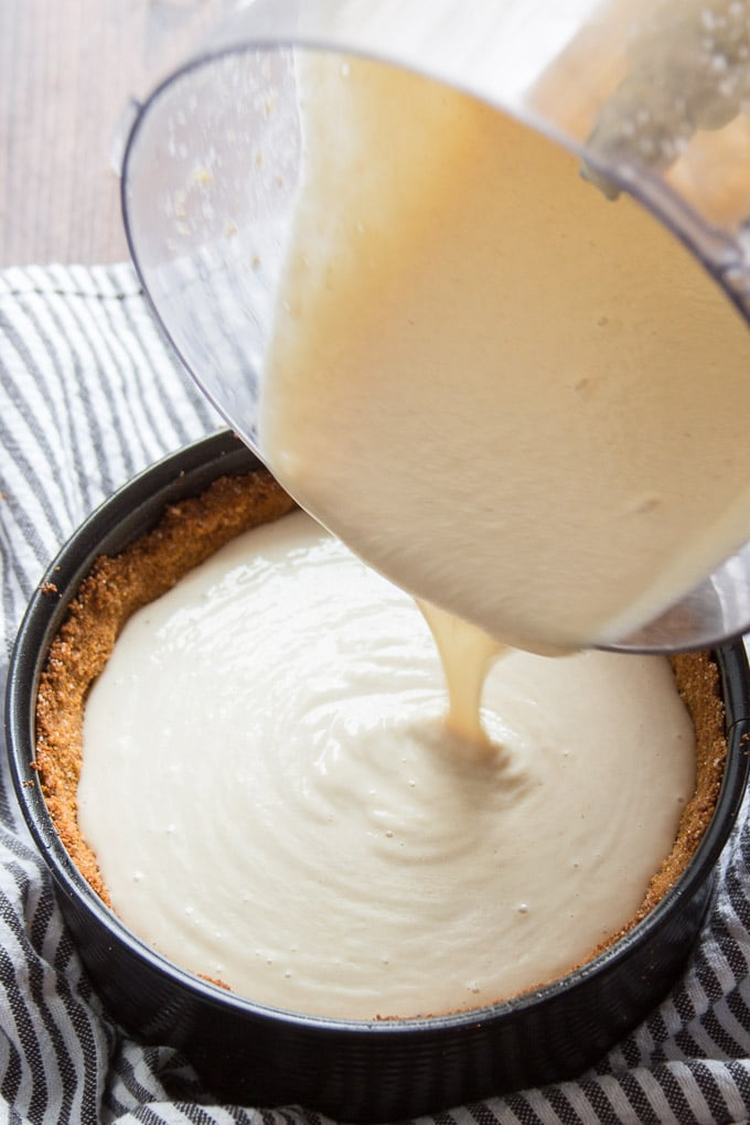 Vegan Cheesecake Batter Being Poured Into a Crust