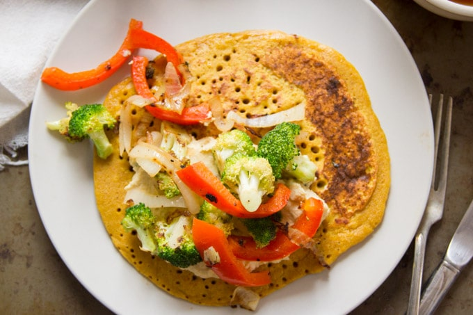 Vegan Omelet on a Plate with Cashew Cheese and Veggies on Top