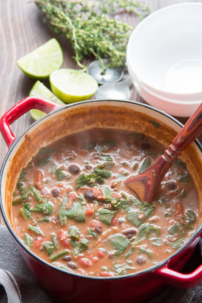 Caribbean Bean Soup with Collard Greens in a Pot with Serving Spoon