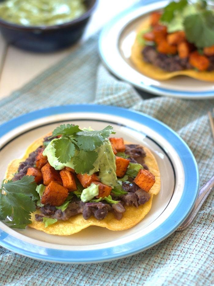 Black Bean and Chipotle Roasted Sweet Potato Tostadas with Avocado Lime Crema