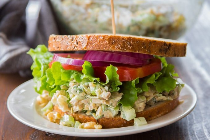 Vegan Chicken Salad Sandwich Topped with Lettuce, Tomato and Onion
