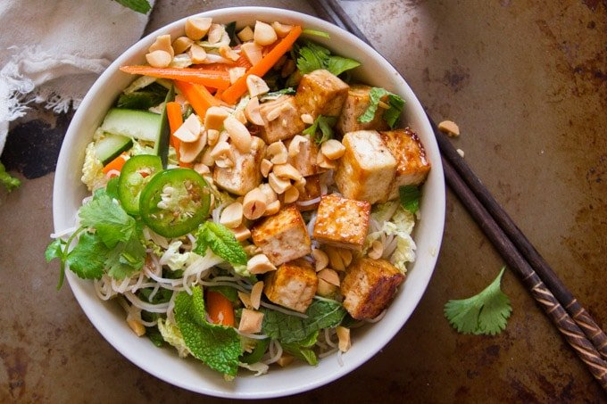 Top View of a Bowl of Vietnamese Rice Noodle Salad with Hoisin Glazed Tofu with Chopsticks