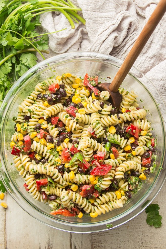 Bowl of Southwest Pasta Salad on a White Wooden Surface