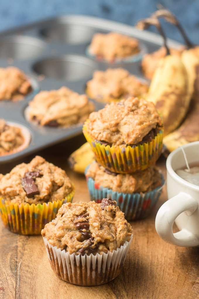 Vegan Banana Muffins with Teacup, Muffin Tin and Bananas in the Background