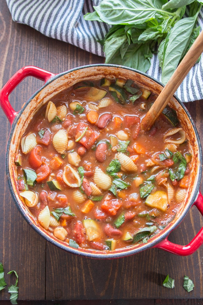 Pot of Vegan Minestrone Soup with Napkin and Basil Leaves