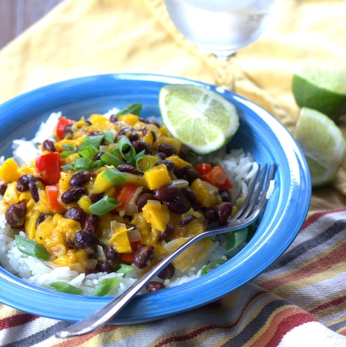 Black Bean Mango Bowl with Fork and Lime Wedges