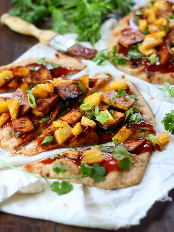 Whole wheat naan bread is topped with spicy hoisin barbecue sauce and ...