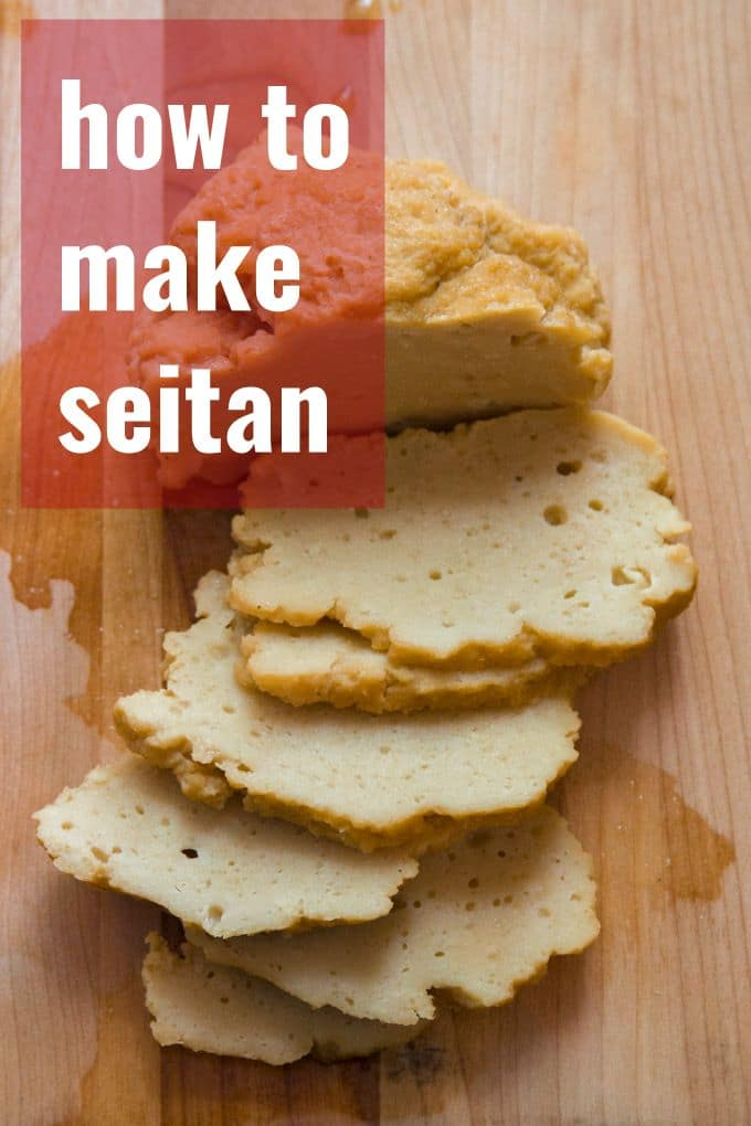 "Overhead View of a Sliced Piece of Seitan on a Cutting Board with Text Overlay ""How to Make Seitan"""
