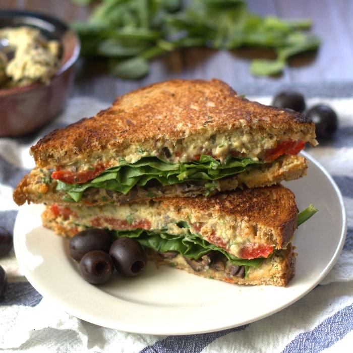 Whole grain bread is stuffed with veggies, creamy black olive hummus ...