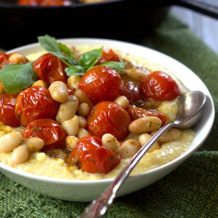 Pesto Roasted Cherry Tomatoes and White Beans over Vegan Cheesy Polenta