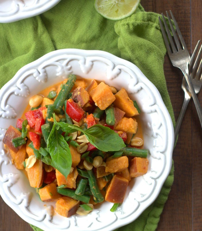 Bowl of Thai Sweet Potato Salad with Spoon on a Green Napkin
