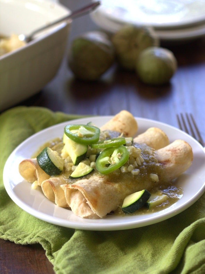 White Bean Enchiladas Verde with Garlic Roasted Corn and Zucchini