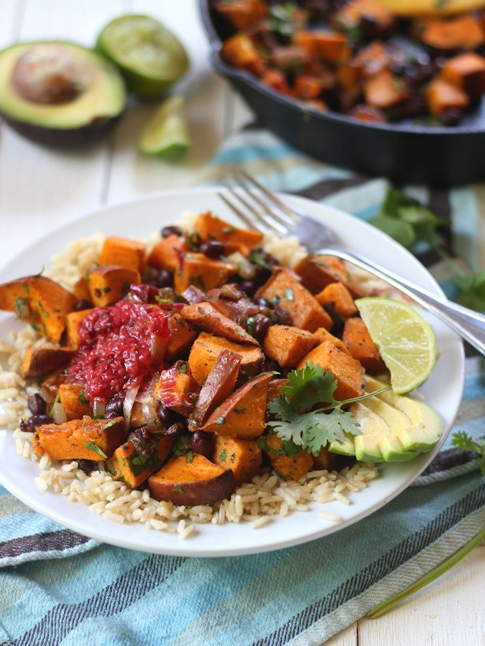 Savory black beans and garlic roasted sweet potatoes are dressed in ...