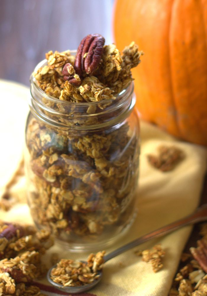 Jar of Pumpkin Granola with a Pumpkin in the Background