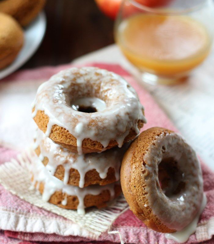 Stack of Vegan Gingerbread Doughnuts with Glass of Apple Cider in the Background