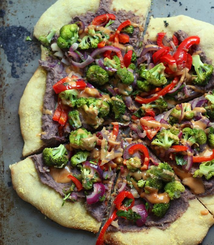 Sliced Vegan Mexican Pizza on a Distressed Metal Surface