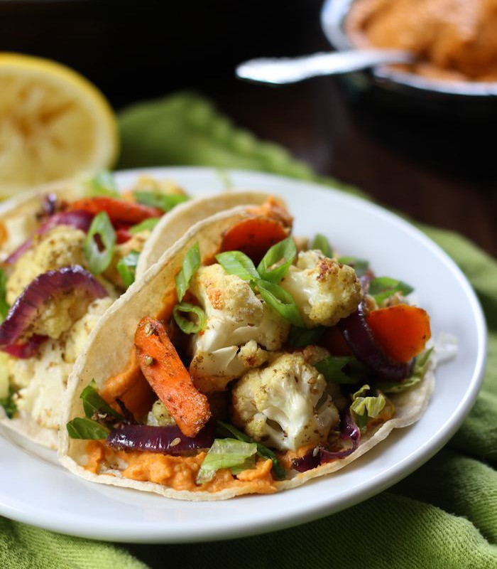 Close Up of Two Roasted Veggie Tacos on a Plate