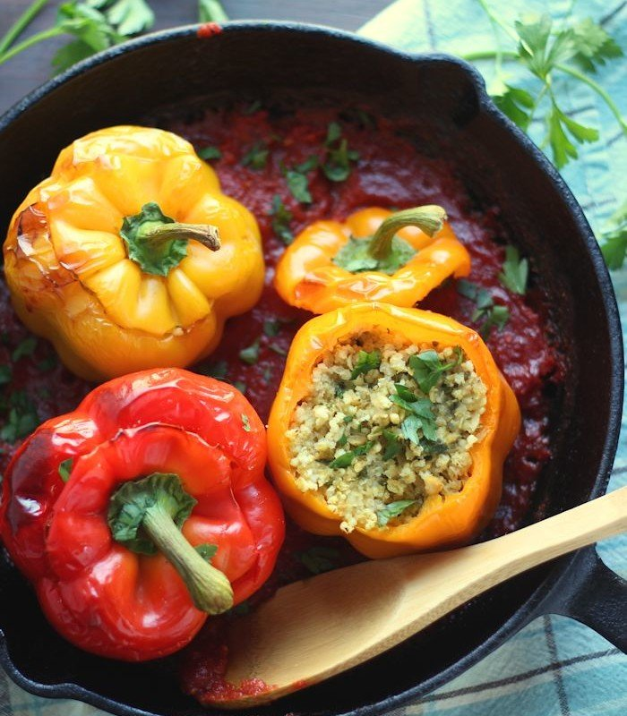 Four Falafel Stuffed Peppers in a Skillet with Tomato Sauce