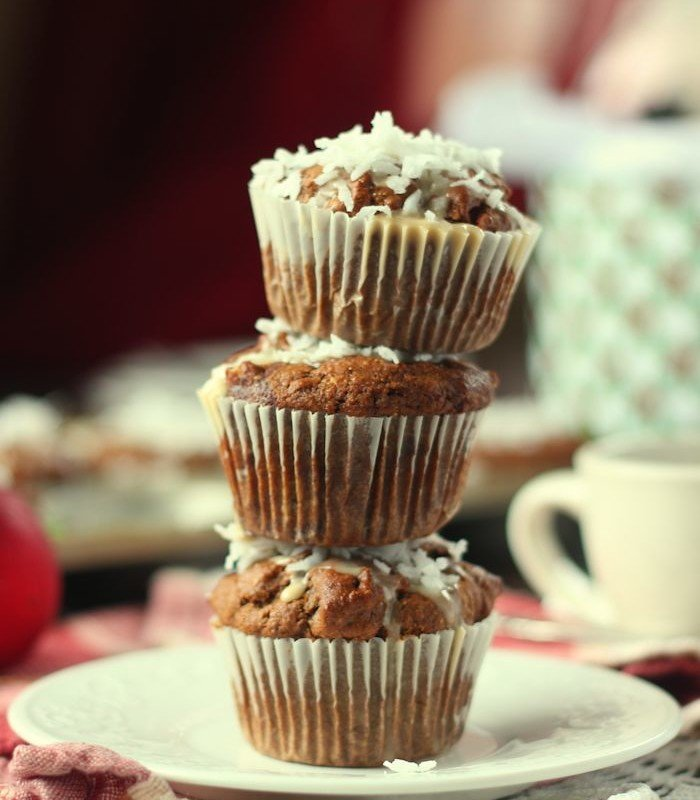 Stack of Three Gingerbread Latte Muffins with Coffee Cup in the Background