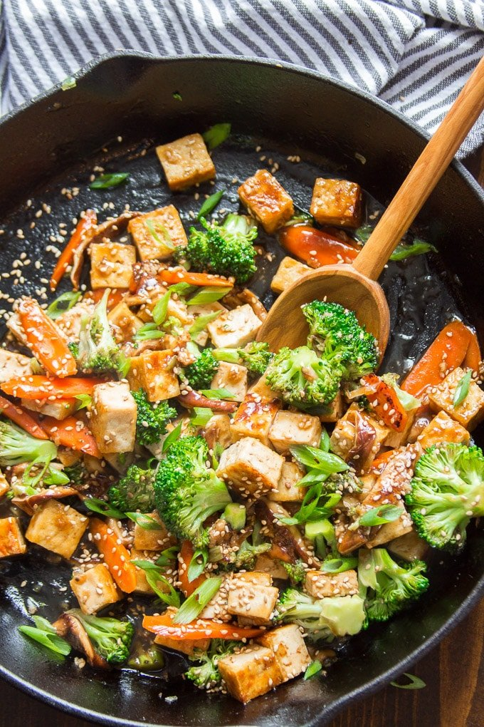Tofu Stir-Fry in a Skillet with Serving Spoon