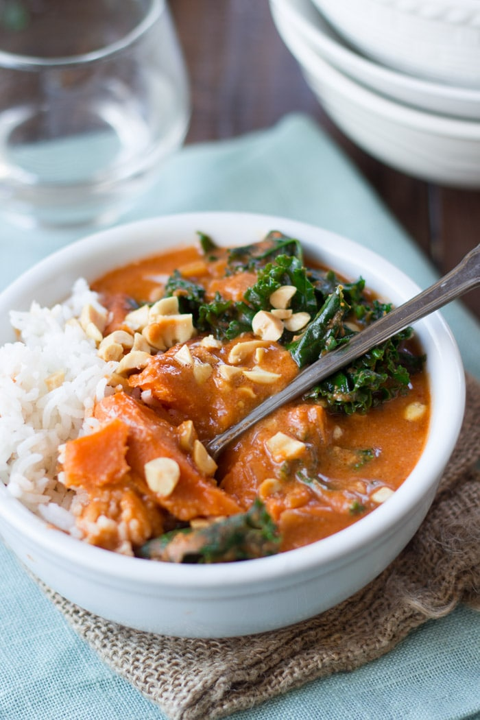 slabs are nestled in tender kale leaves and savory African peanut stew ...