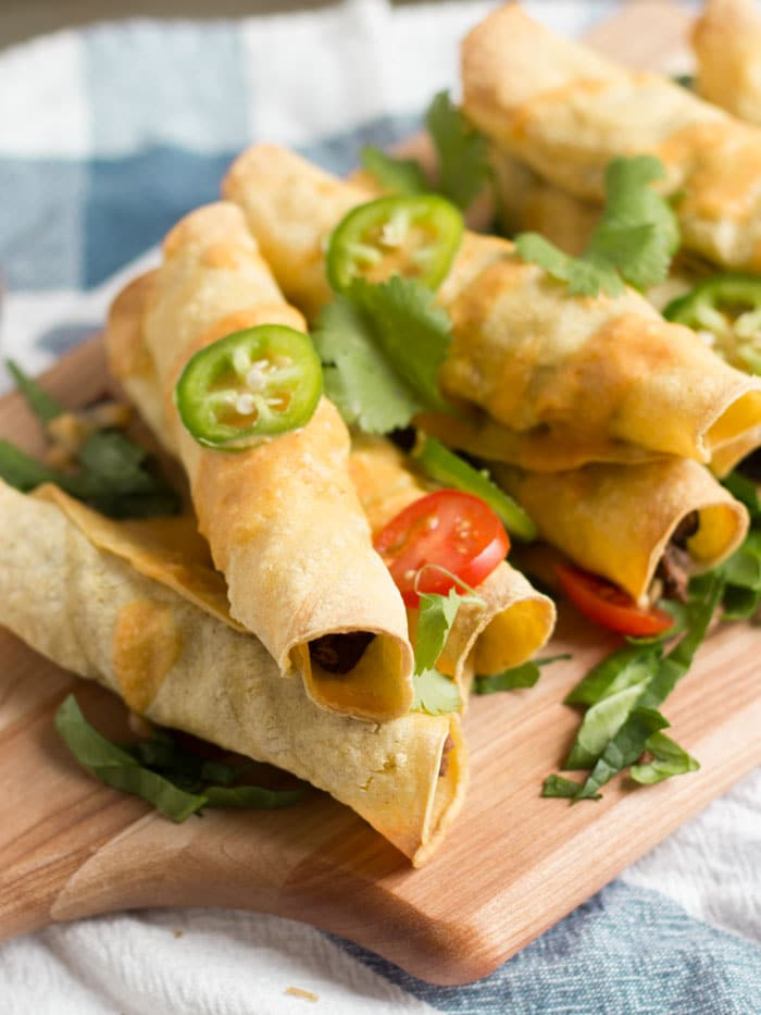 These black bean taquitos are baked up in crispy corn tortilla shells ...