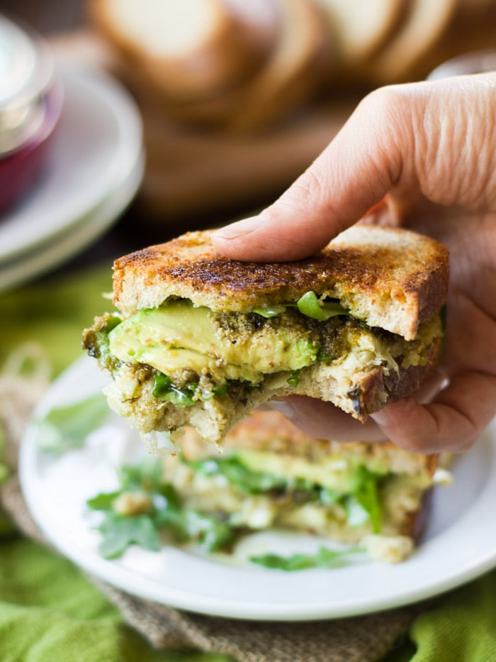 hearts and creamy avocado slices are drizzled with garlicky pesto ...