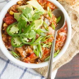 Overhead View of a Bowl of One-Pot Quinoa Chili Topped with Avocado and Jalapeno Slices