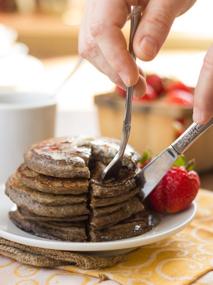 Fork and Knife Cutting Into a Stack of Vegan Buckwheat Pancakes