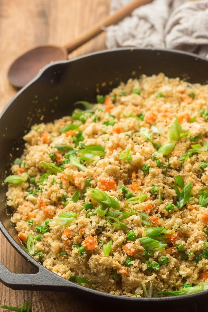 Close Up of Cauliflower Fried Rice in a Cast Iron Skillet