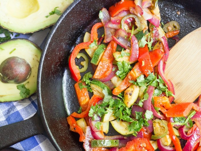 Skillet Filled with Veggies for Making Loaded Vegan Quesadillas