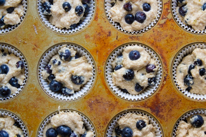 Muffin Tin Filled with Blueberry Muffin Batter
