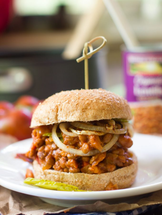 Vegan Sloppy Joe Sandwich on a Plate Topped with Onion Slices