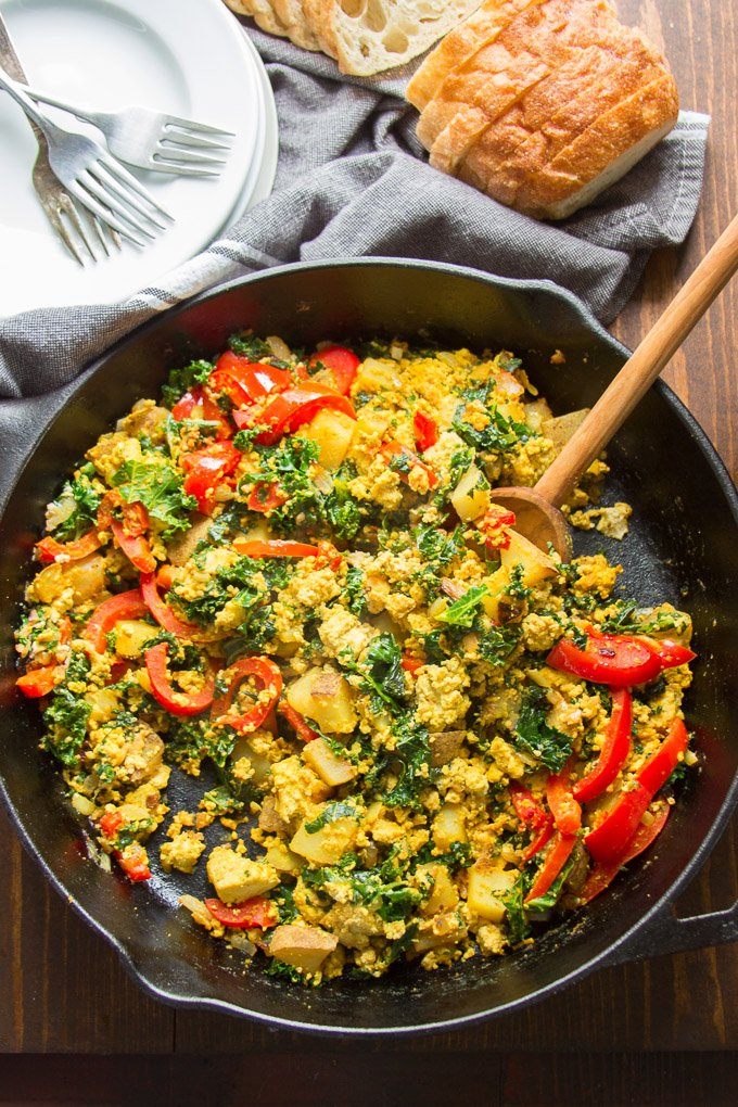 Skillet Filled with Tofu Scramble with Wooden Spoon