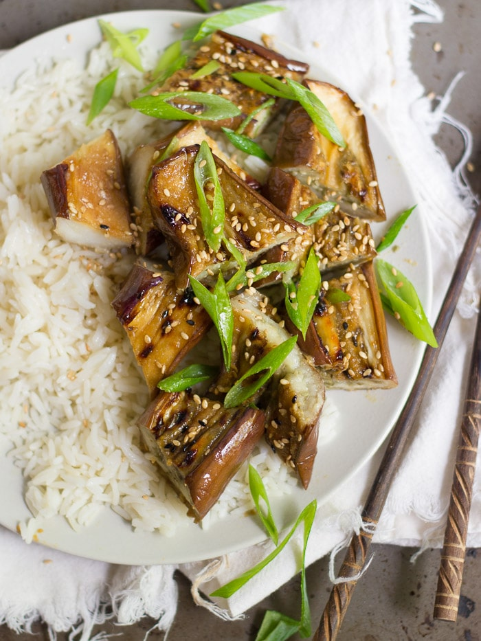 Close up of Miso Glazed Eggplant and Rice on a Plate, Topped with Scallions