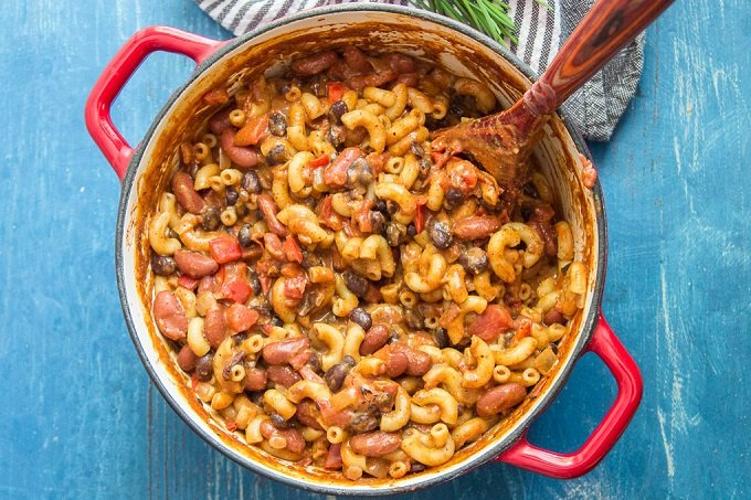 A Pot of Vegan Chili Mac & Cheese with Serving Spoon