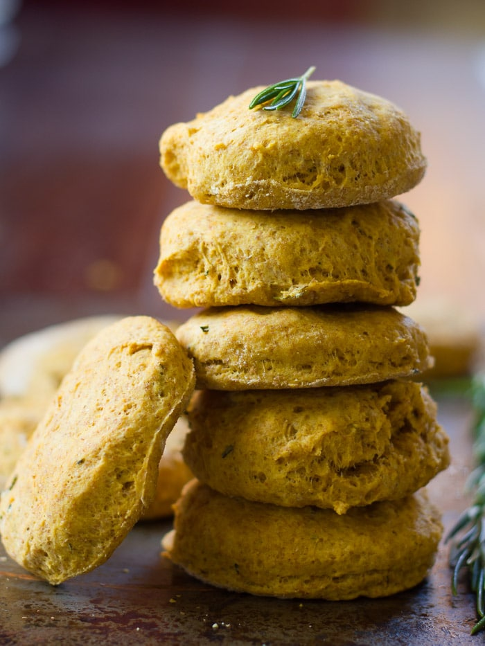 Stack of Vegan Pumpkin Biscuits with Sage Leaves on Top