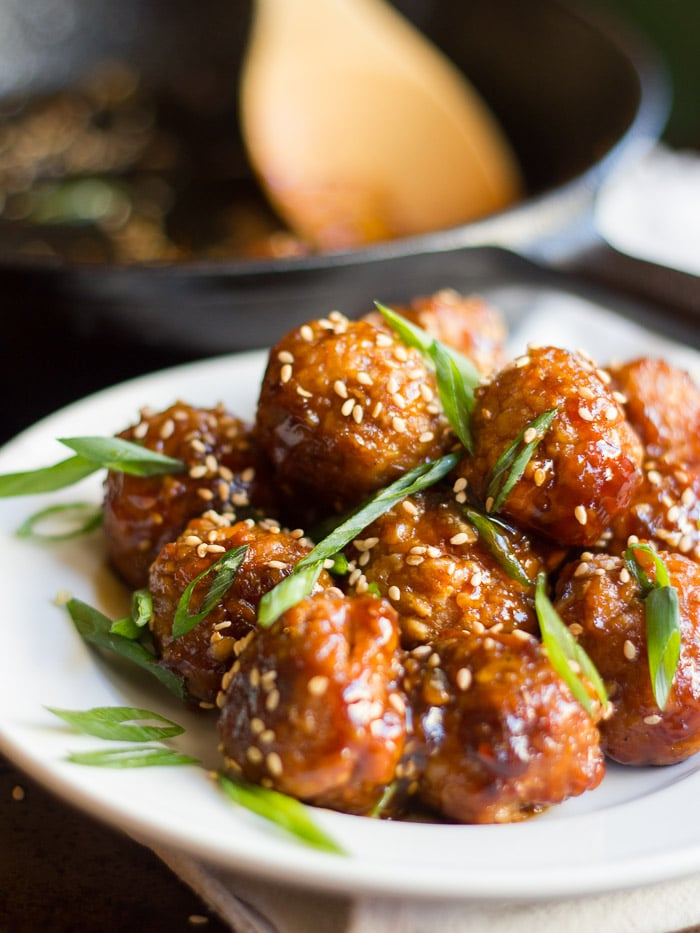 Teriyaki Tempeh Meatballs on a Plate with Sesame Seeds and Scallions