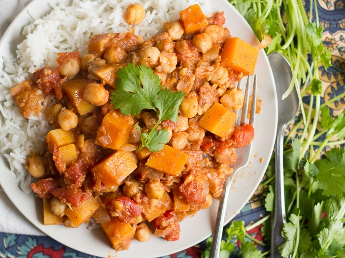 Overhead View of Butternut Squash Chana Masala on a Plate with Fork