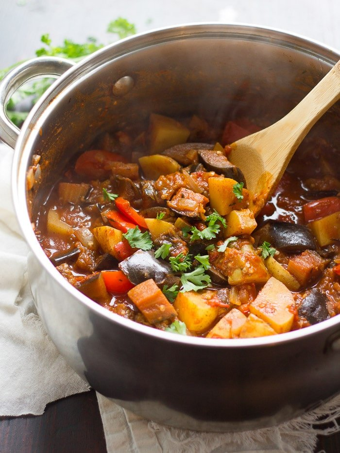 Eggplant Goulash in a Pot with Wooden Spoon