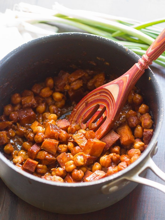 Sweet Potato & Chickpeas in Barbecue Sauce in a Pot with Wooden Spoon