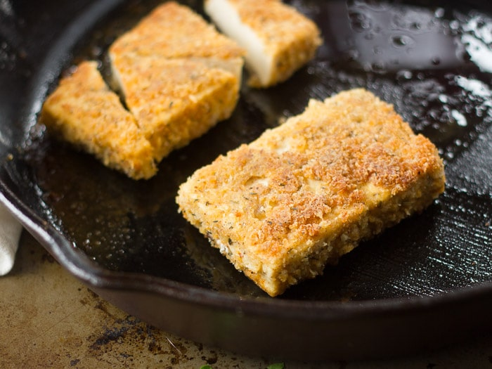 Two Crispy Tofu Steaks in a Skillet