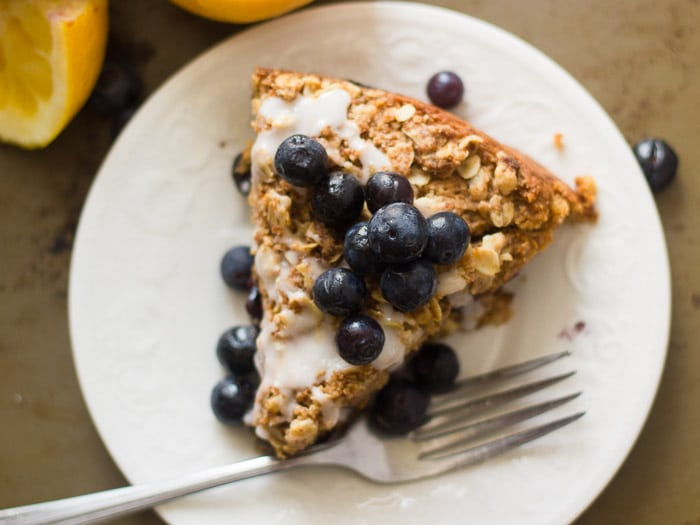 Overhead View of a Slice of Vegan Lemon Blueberry Coffee Cake on a Plate with Fork