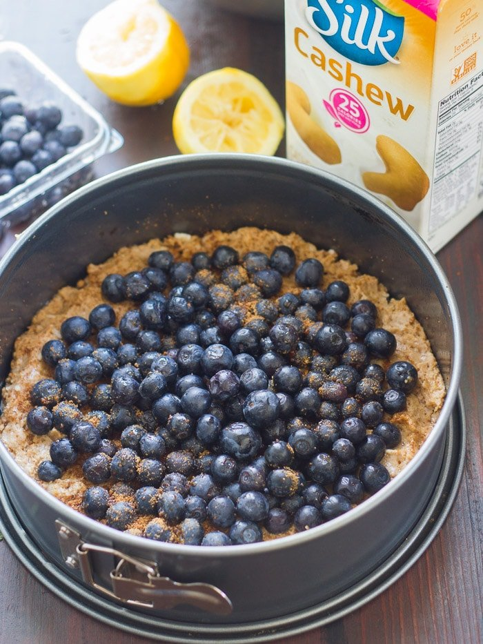 Vegan Lemon Blueberry Coffee Cake Batter and Fresh Blueberries in a Springform Pan
