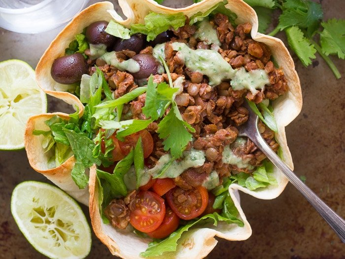Overhead View of a Lentil Walnut Vegan Taco Salad in a Crispy Tortilla Bowl