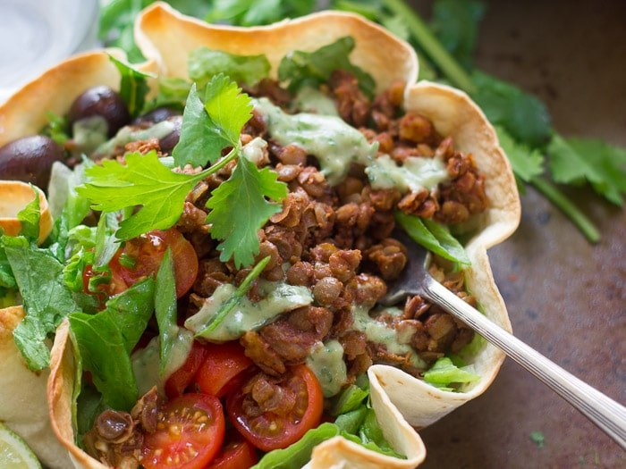 Close Up of a Vegan Lentil Walnut Taco Salad with a Fork